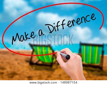 Man Hand Writing Make A Difference With Black Marker On Visual Screen