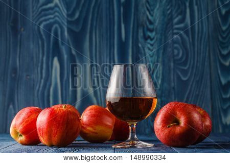 Glass Of Calvados Brandy And Red Apples