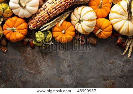 Fall background copy space with pumpkins overhead shot