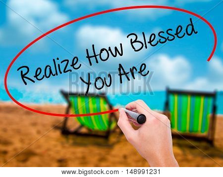 Man Hand Writing  Realize How Blessed You Are  With Black Marker On Visual Screen