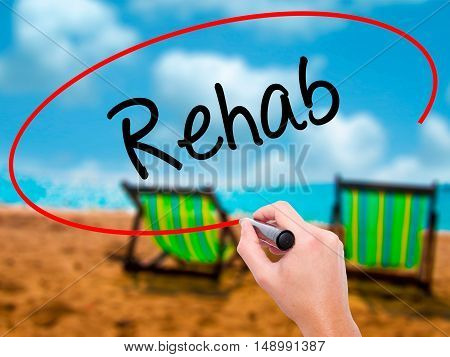 Man Hand Writing Rehab With Black Marker On Visual Screen