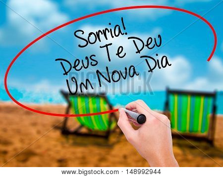 Man Hand Writing Sorria! Deus Te Deu Um Novo Dia (smile! God Gives You Another Day In Portuguese) Wi