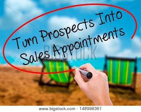 Man Hand Writing Turn Prospects Into Sales Appointments With Black Marker On Visual Screen.