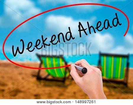 Man Hand Writing Weekend Ahead With Black Marker On Visual Screen