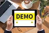 DEMO (Demo Preview Trailer Trial Ideal) on tablet on screen table and coffee Business poster