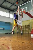 competition cencept with people who playing basketball in school gym poster