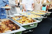 people choosing food from table on catering and buffet party on business seminar conference or wedding poster