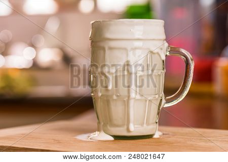 Closeup View Fresh Kefir Probiotik Drink In Overfilled Clear Glass Cup On Kitchen Table.