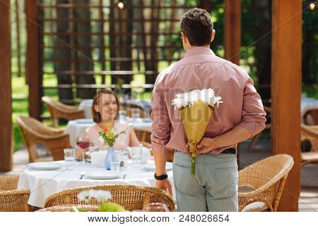 Congratulating Wife. Dark-haired Handsome Man Wearing Stylish Pink Shirt Congratulating His Wife Wit