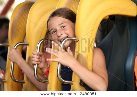 Cute Girl Riding On A Roller Coaster