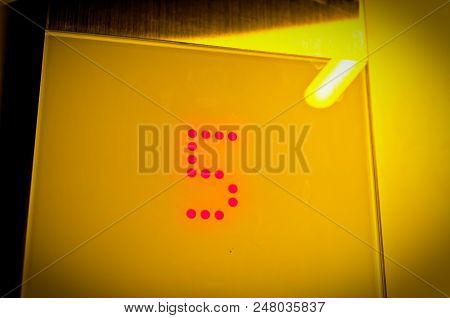 Elevator Display Of The Floor With The Number 5 In Yellow Optics