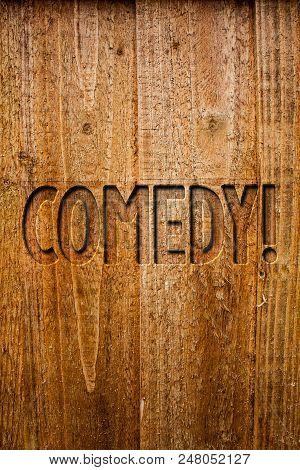 Text sign showing Comedy Call. Conceptual photo Fun Humor Satire Sitcom Hilarity Joking Entertainment Laughing Ideas messages wooden background intentions feelings thoughts communicate poster