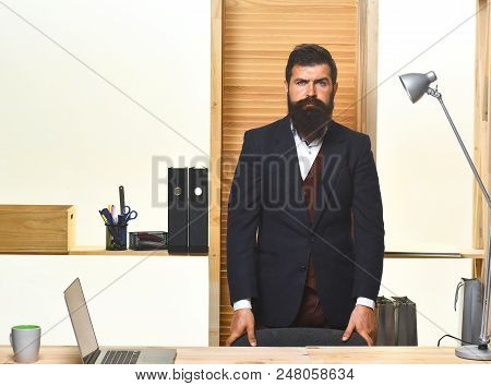 Portrait Of Bearded Businessman. Bearded Businessman Standing At Table. Successful Businessman. Offi