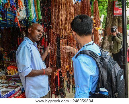 Bodhgaya, India - July 9, 2015. Vendor At Street Market In Bodhgaya, India. Bodhgaya Is The Most Rev