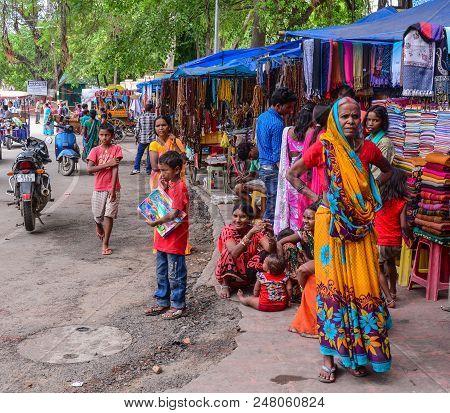 Bodhgaya, India - July 9, 2015. Local People In Colorful Dress On Street In Bodhgaya, India. Bodhgay