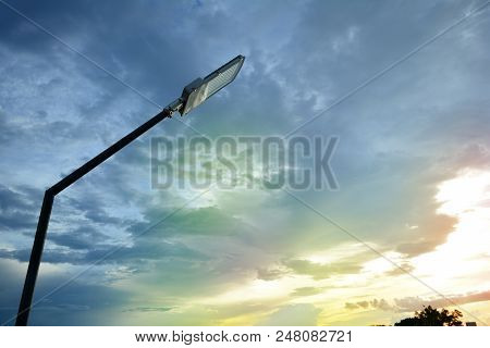 The Lamp Post With Sky And Shining Light Of The Sun In The Morning