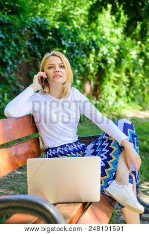 Woman Laptop In Park Enjoy Green Nature And Fresh Air. Girl Dreamy Takes Advantage Of Online Shoppin