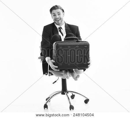 Funny Business Concept. Office Worker With Silly Face Spinning In Chair. Businessman Smiles Isolated