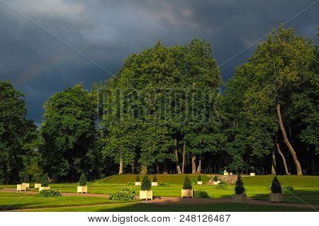 Ancient European Park Before The Storm. Dark Storm Sky
