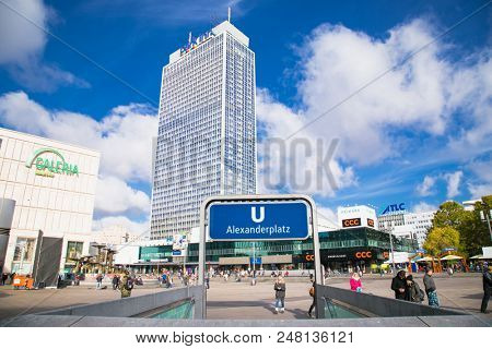 BERLIN GERMANY - OCT 30, 2016: People near fountain on Alexanderplatz square in Berlin city on Oct 30, 2016. Germany. Alexanderplatz is large public square and transport hub in central Mitte district