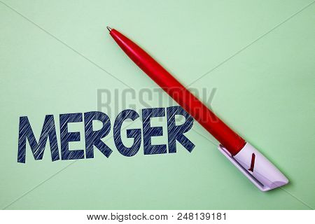 Handwriting Text Merger. Concept Meaning Combination Of Two Things Or Companies Fusion Coalition Uni