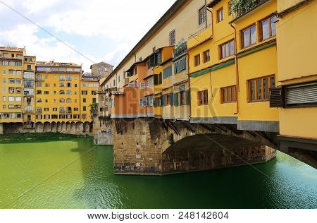 Close up view of Ponte Vecchio the famour arch bridge across Arno river in Florence (Firenze), Tuscany, Italy poster