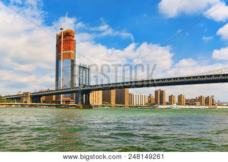 New York View Of The Lower Manhattan And The Manhattan Bridge Across The East River.