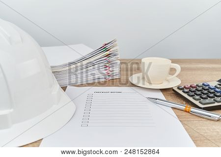 Pen On Checklist Have Engineer Hat And Coffee As Background
