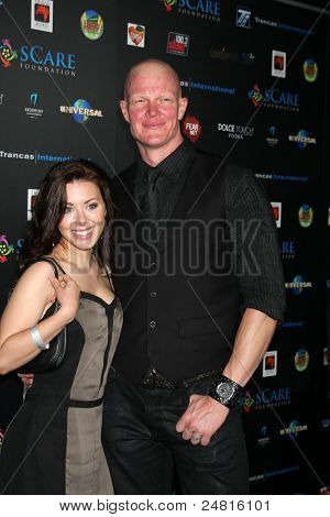 LOS ANGELES - OCT 30:  Jamie Slater, Derek Mears arrives at the sCare Foundation Halloween Launch Benefit at Conga Room - LA Live on October 30, 2011 in Los Angeles, CA