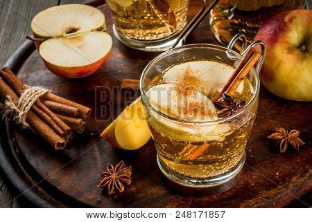 Autumn And Winter Drinks. Traditional Home-made Apple Cider, Cocktail Of Cider With Aromatic Spices