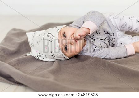 Cute Baby On White Background.close Up Head Shot Of A Caucasian Baby Girl, Six Months Old Baby