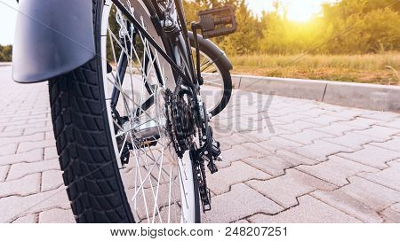 New Bicycle . Active Lifestyle Concept . Sprocket On Bicycle Wheel . The Beautiful Bicycle In The Ci