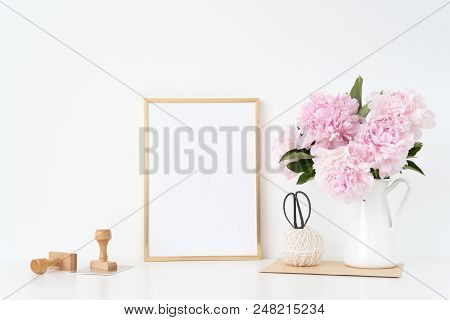 Gold Portrait Frame Mock Up With A Pink Peonies With Stamps Beside The Frame, Overlay Your Quote Or