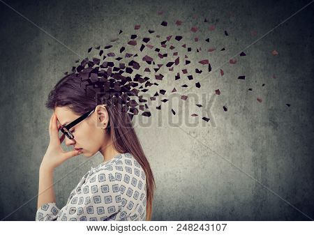 Memory Loss Due To Dementia Or Brain Damage. Young Woman Losing Parts Of Head As Symbol Of Decreased