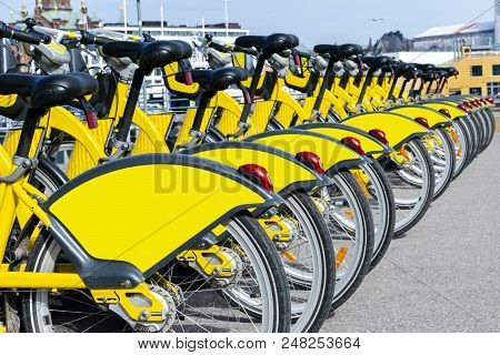 Row Of Bicycles Parked Along The Beach. Row Of Parked Colorful Bicycles. Rental Bicycles. Pattern Of