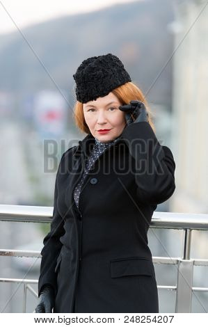 Styled Woman In Black Coat. Rude Lady In Coat, Hat And Gloves. Woman's Serious Look At You. Lady Coq