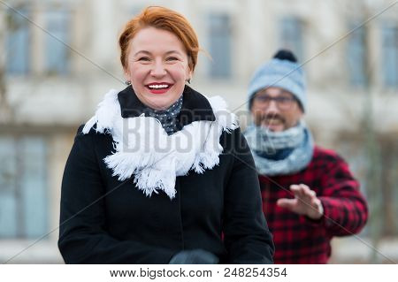 Happy Woman Gone From Man In Glasses. Smiling Woman Go Away From Man. Guy Catching Up Happy Woman On