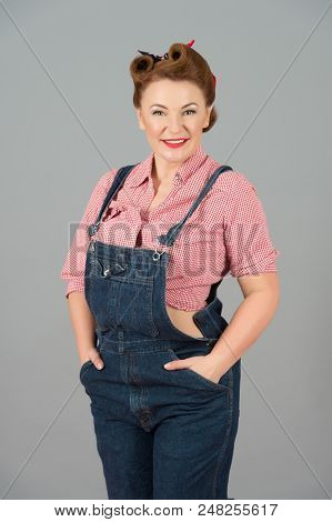 Brunette Pretty Woman In Pin-up Style And Denim On Grey Background. Concept Of Denim Dress And Pin-u