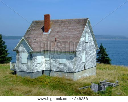 Old abandoned boarded up house on Moshers Island Lighthouse Lahave Lunenburg County Nova Scotia Canada poster