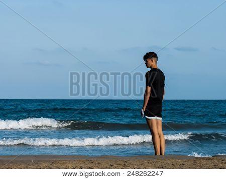 Boy Looking At The Mediterranean Sea, Boy Looking At The Horizon In The Mediterranean
