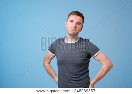 Indoor Shot Of Serious Middle Aged European Male Frowns Face, Being Offended By People Who Jokes At