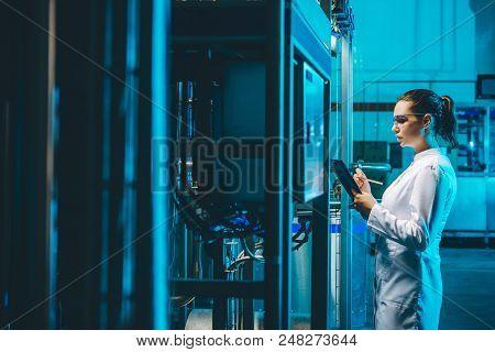 Modern Factory Worker Technology Blue Milk Production