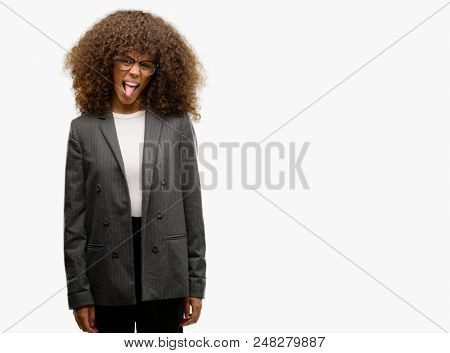 African american business woman wearing glasses sticking tongue out happy with funny expression. Emotion concept.