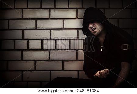 Drug abuse concept. overdose male drug addict hand, drugs narcotic syringe in action poster