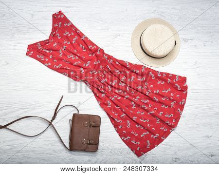 Fashionable Concept. Female Summer Wardrobe. Straw Hat, Red Sundress, Handbag. Top View