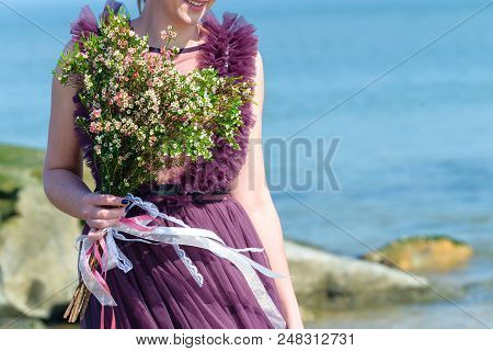 Unidentified Bride In Beautiful Wedding Dress Holding Gentle Nice Bridal Bouquet With Fresh Blooming