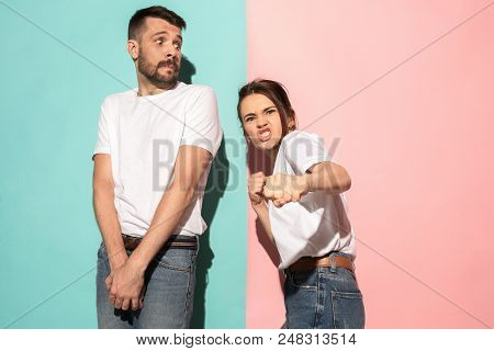Hate, Rage. Crying Emotional Angry Woman On Pink Studio Background And Frightened Man On Blue. Emoti