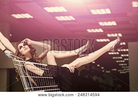 Fashion Purchases. Girl In Fashionable Dress, Shoes In Trolley In Shop. Sensual Woman Sit In Shoppin