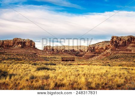 Old saloon in a typical southwestern landscape near the village of Bluff, Utah poster