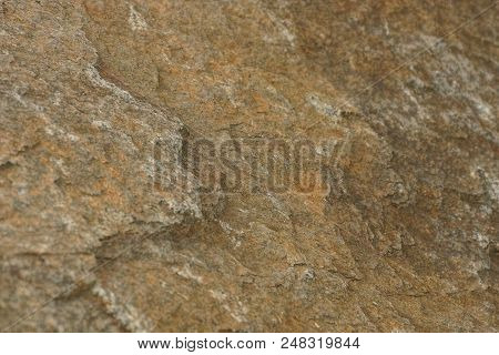 Brown Texture Of A Large Stone In The Wall